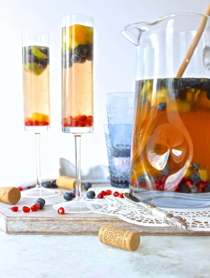 This easy, pretty, and fruity sangria recipe is the perfect pool side drink to make this summer! #sangria #summer #drinkrecipe #sangriarecipe #rainbow via frostinandfettuccine.com