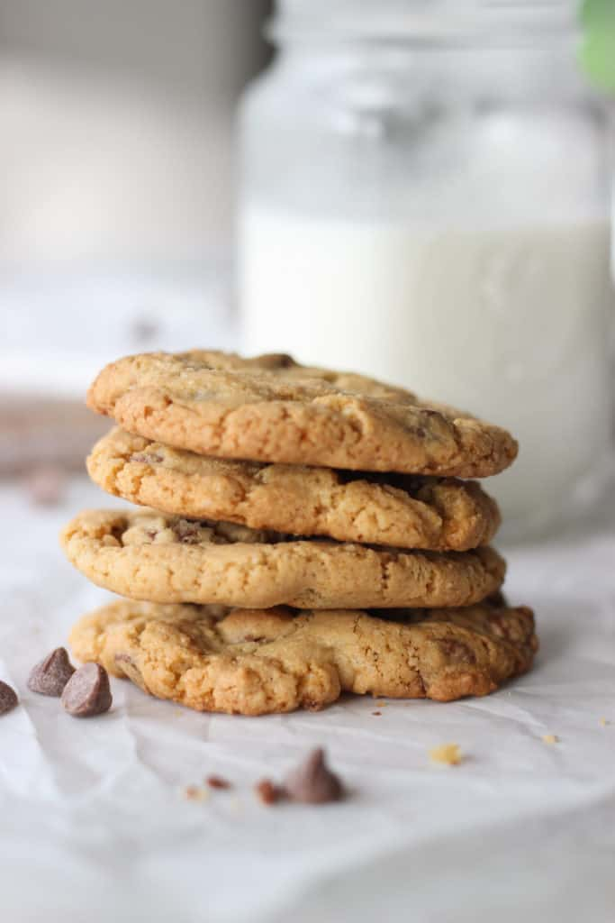 stack of four homemade chocolate chip cookies