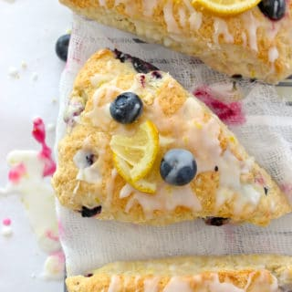 Closeup of blueberry lemon scones sitting on cheesecloth