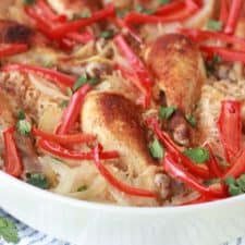 An easy one pan arroz con pollo recipe in a white dish served on a table.