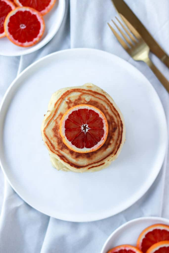 If you're looking for fluffy, easy, stackable, drool worthy pancakes with a hint of citrus, then these are the pancakes for you! #pancakes #bloodorange #fluffy frostingandfettuccine.com