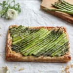 Spring is almost here! Celebrate with this asparagus tart that lays on a bed of caramelized onion and cheese. #drool #spring #asparagustart Frostingandfettuccine.com