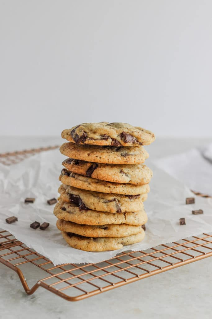 Coffee cookies stacked on a cooling rack with parchment paper