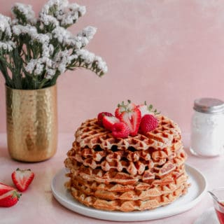 Crispy on the outside, chewy on the inside, these waffles are bursting with strawberry flavor and are a perfect way to treat mom on Mothers Day! #mothersday #breakfastinbed #strawberrywaffles #waffles frostingandfettuccine.com
