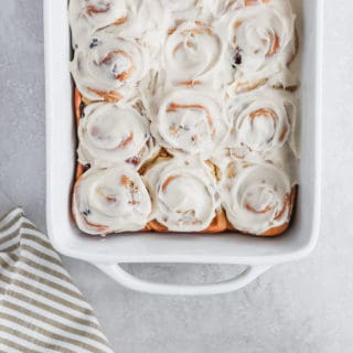 Bourbon Soaked Cherry Cinnamon Buns! Classic cinnamon buns with a nice southern twist. #cinnamonbuns #bourbon #bourbonsoakedcherries #buns frostingandfettuccine.com
