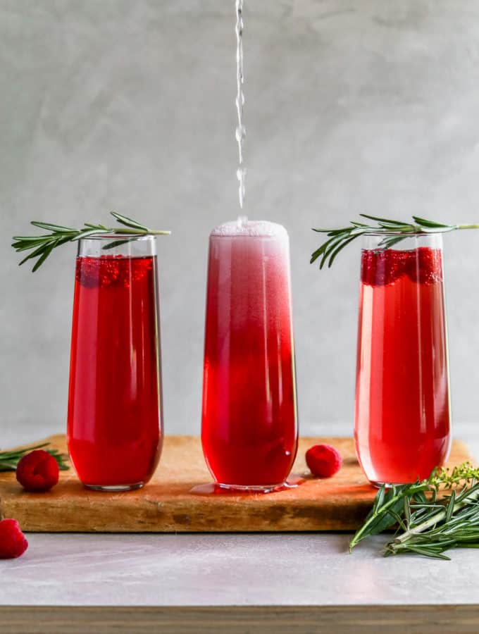 "You're the reason mom drinks anyways so make her these 2 ingredient cranberry raspberry ""Momosas""! #mothersday #mimosa #momosa #cocktails frostingandfettuccine.com"