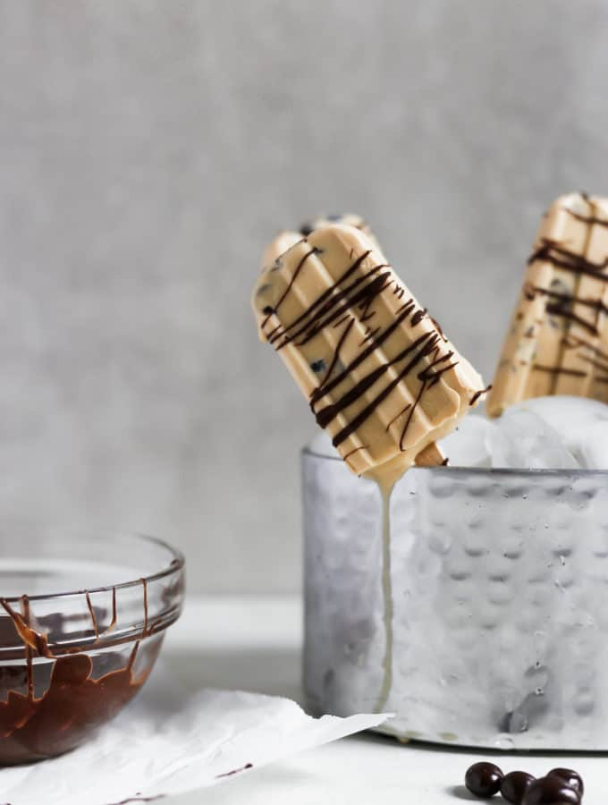 These 3 ingredient coffee popsicles give you an extra buzz and crunch with added chopped espresso beans. The perfect summer treat! #coffee #popsicles #easyrecipe #summer #coffeepopsicles #popsicleweek frostingandfettuccine.com