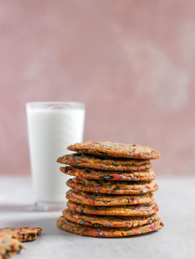 a stack of cookies styled next to a pink background