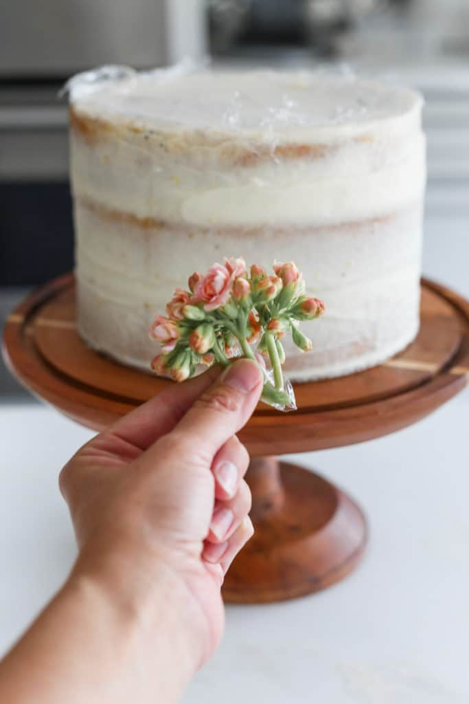 Small bunch of flowers with the stems wrapped in plastic ready to demonstrate how to decorate a cake with flowers.