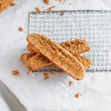 cookie butter biscotti layered on top of each other on a white background.