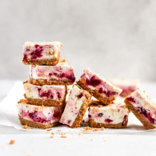 Cranberry cheesecake bars stacked on each other