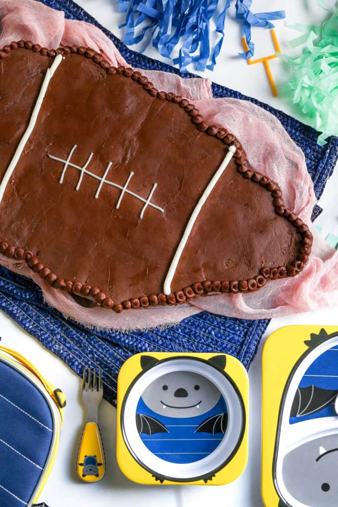 A diy football cupcake cake made styled with products from SkipHop