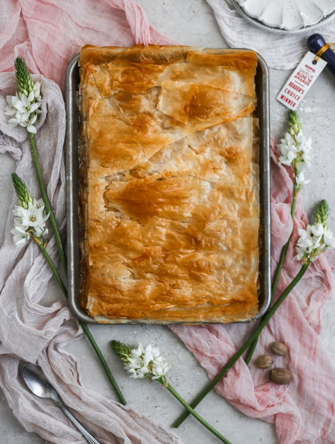 Peach slab pie made with filo dough on a sheet tray