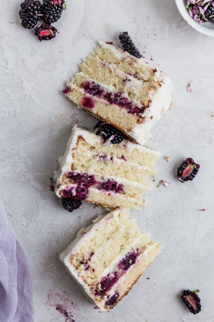 3 slices of white cake displayed ona gray background.