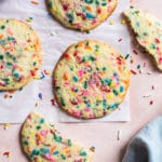 cookies on parchment paper on a pink background