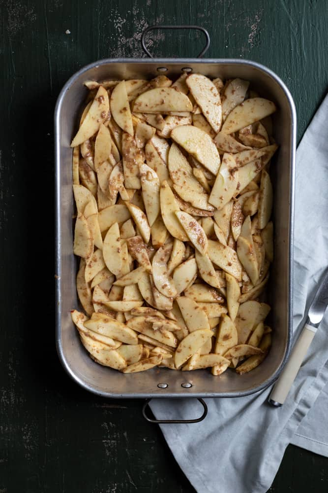Sliced and spiced apples in a baking pan