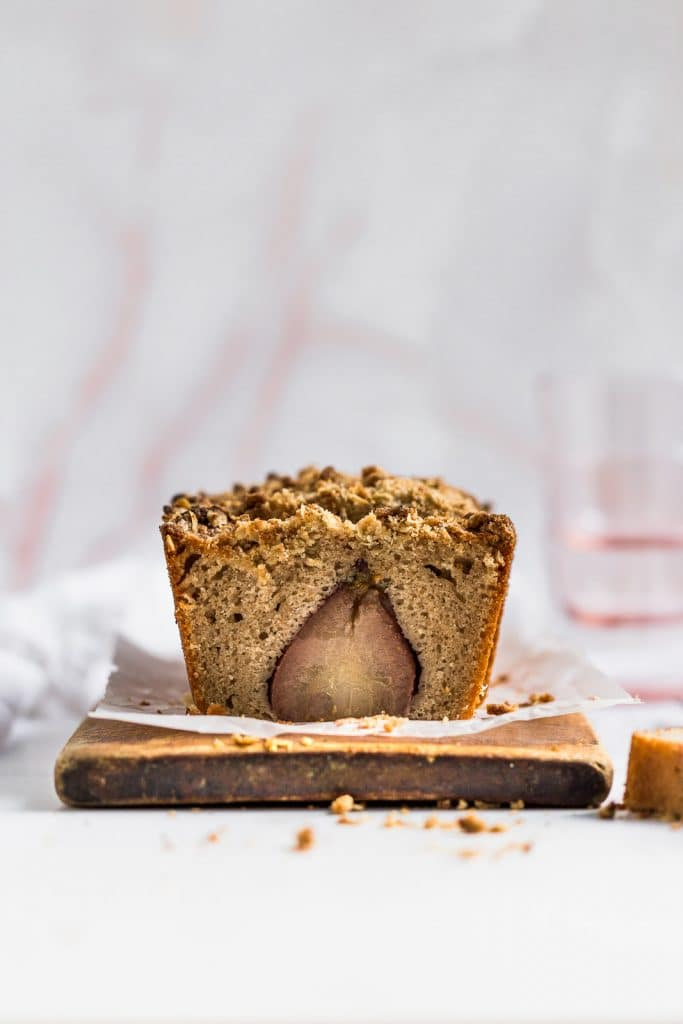 The inside look of a pear baked inside a cake.