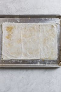 phyllow dough stacks cut into thirds on a sheet tray