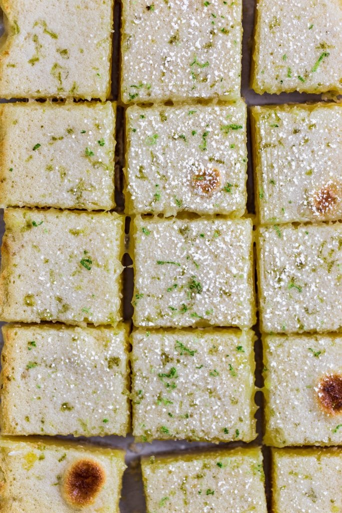 small cut squares of lemon bars topped with lime zest