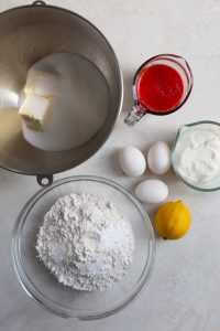 Ingredients for a strawberry bundt cake on a gray background.