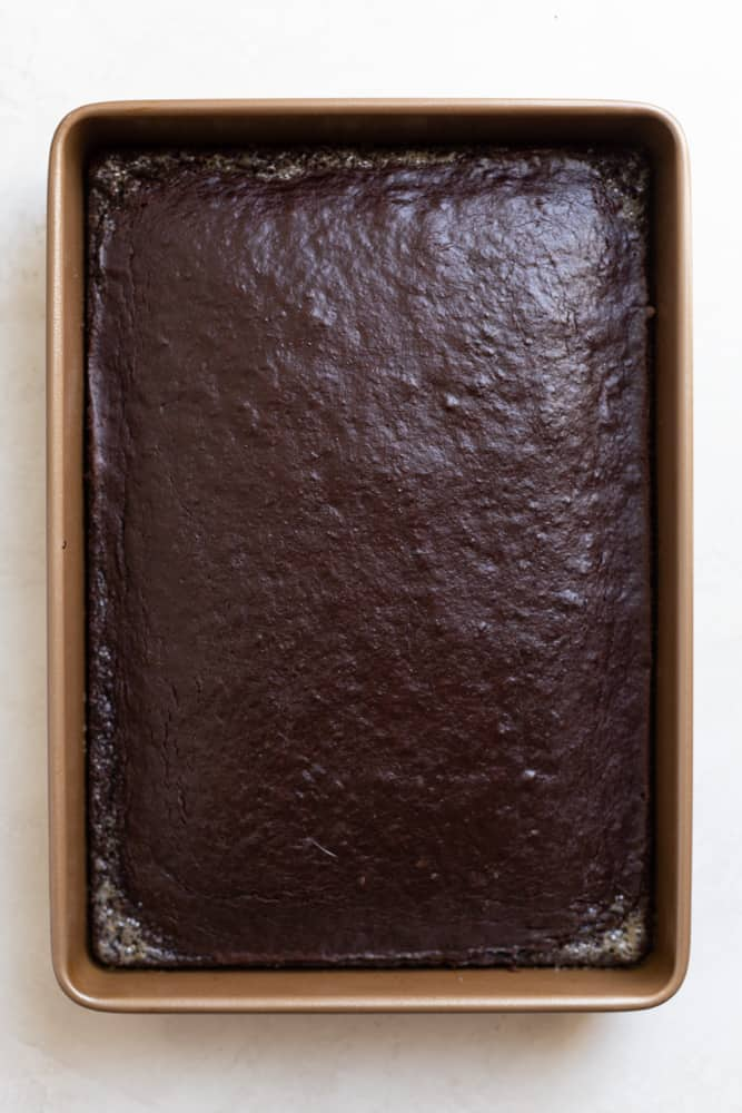 Fully baked and cooled chocolate cake in a 9x13 pan