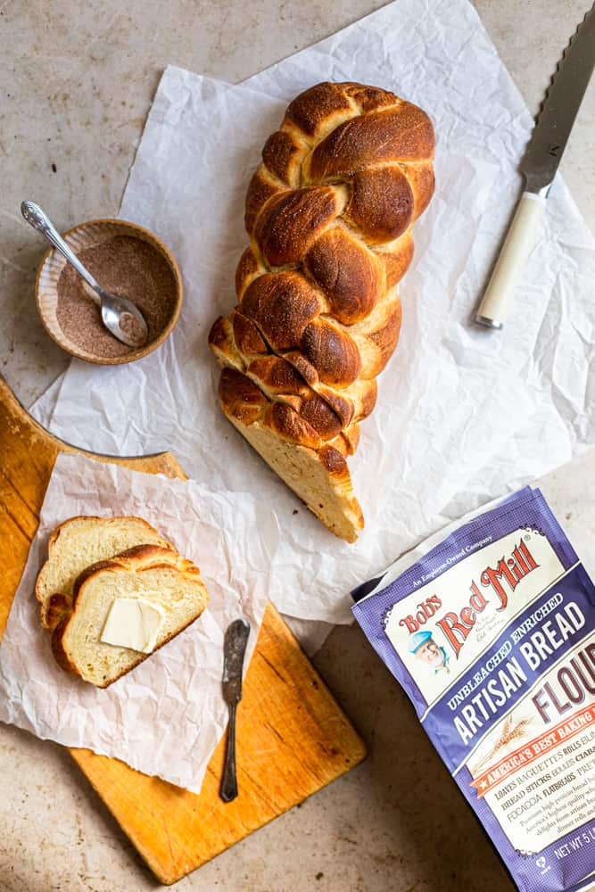 Challah sliced on a piece of white parchment paper