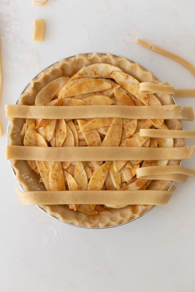 an apple pie with 3 starting lines of lattice crust