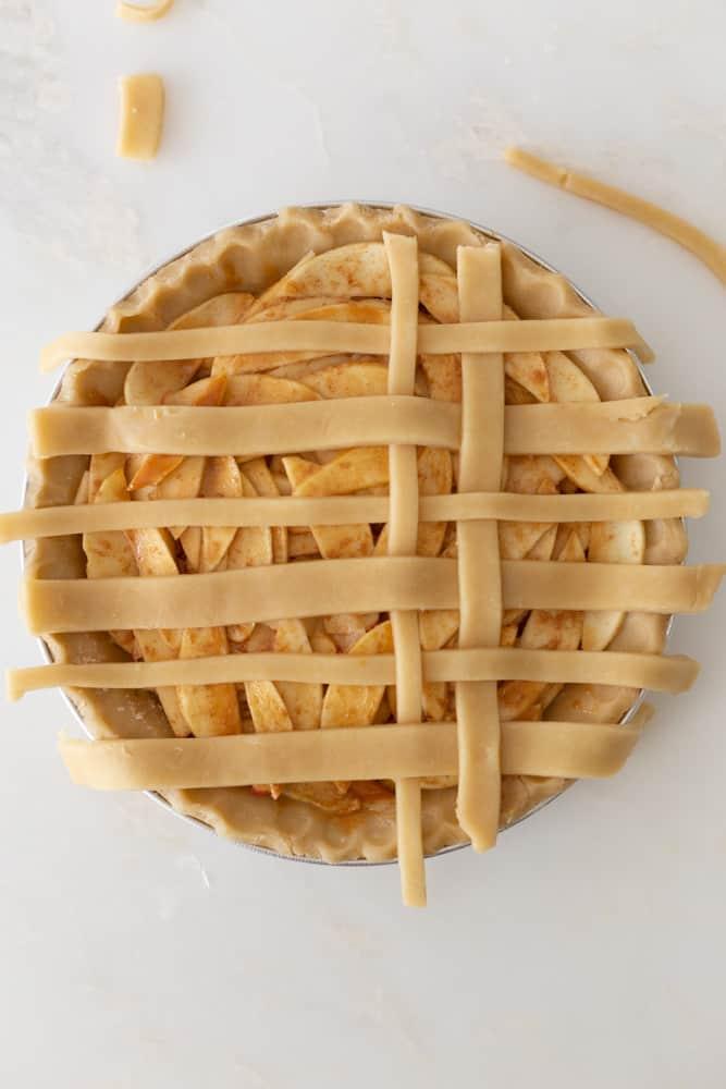 Finishing up a lattice crust on a pie