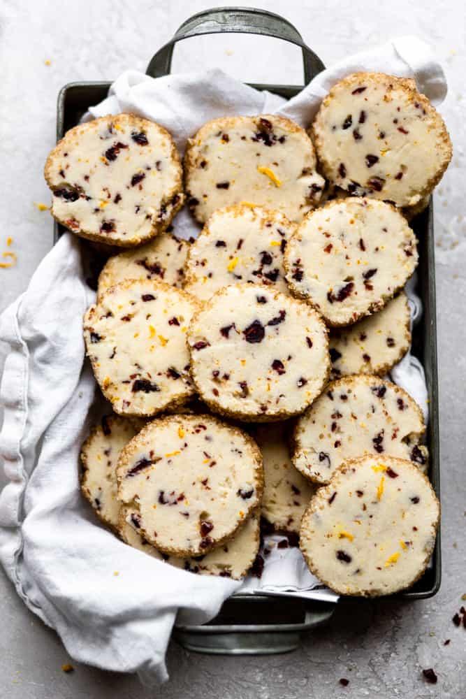 Cranberry orange shortbread cookies lying on a platter