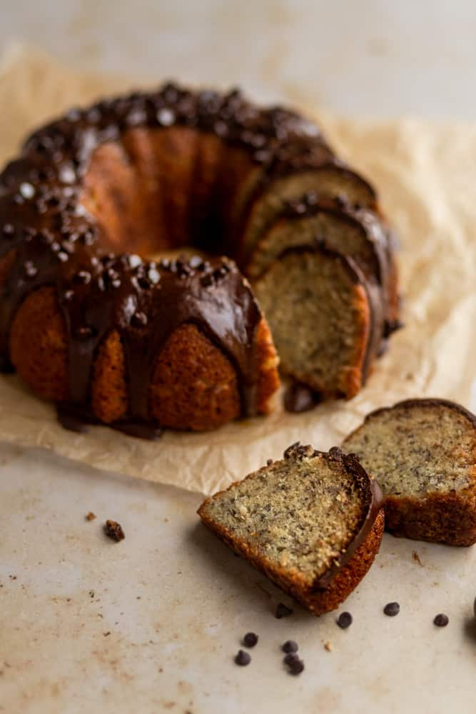 Slices of a banana bundt cake sitting on a tan background