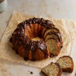 Slices cut out of a banana bundt cake with chocolate glaze