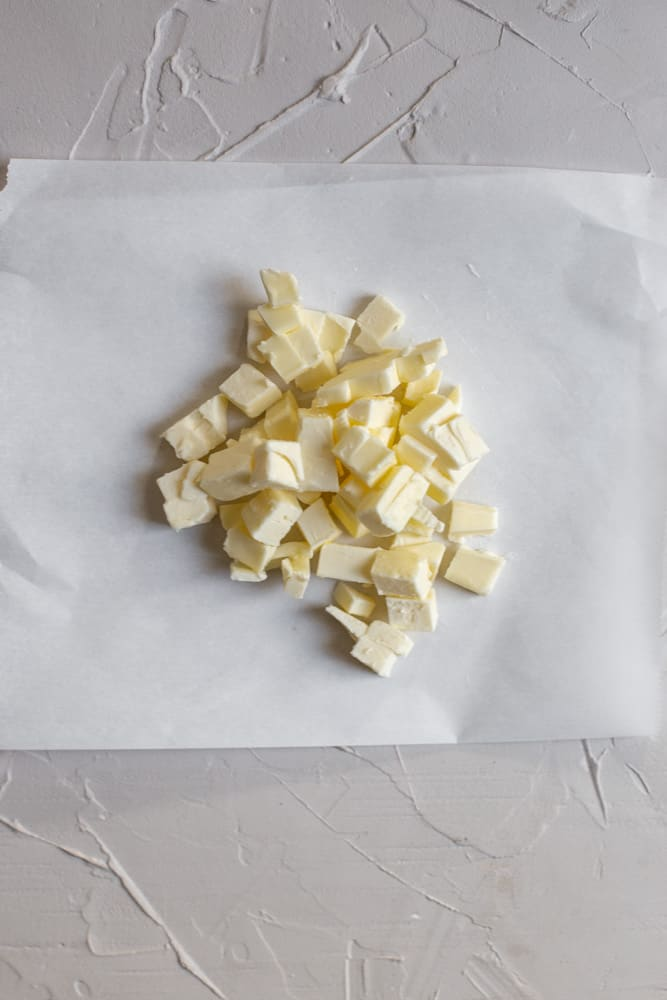 Diced butter on a piece of parchment paper