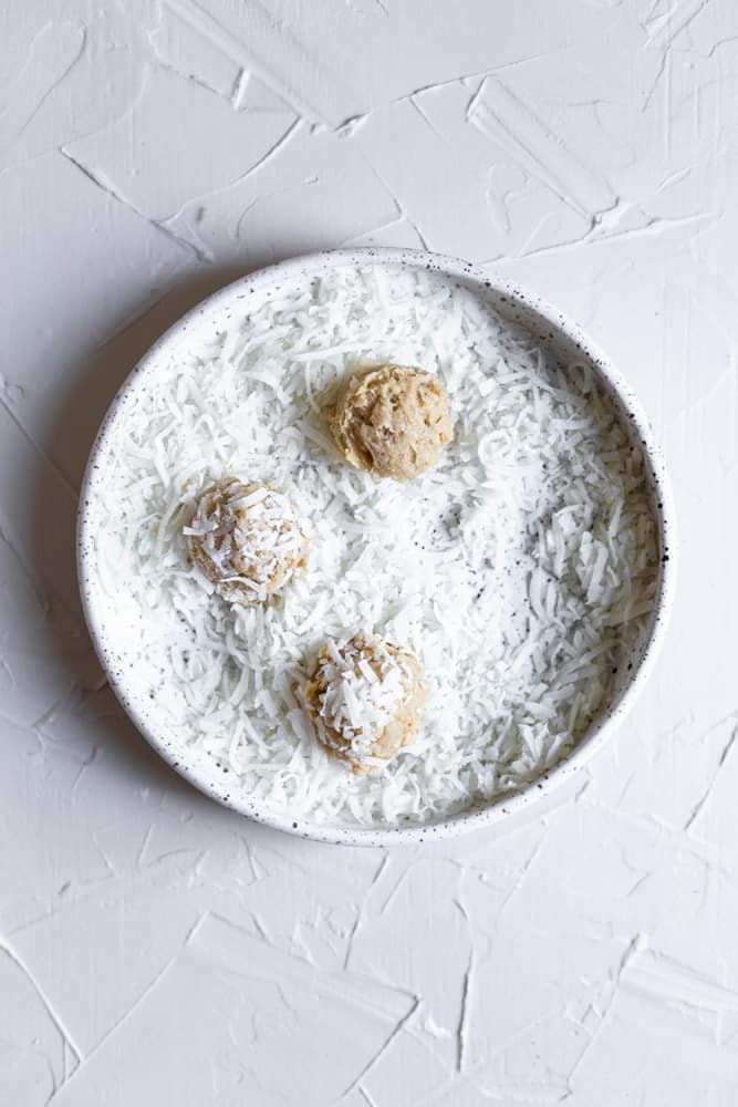 Cookie dough in a bowl with shredded coconut