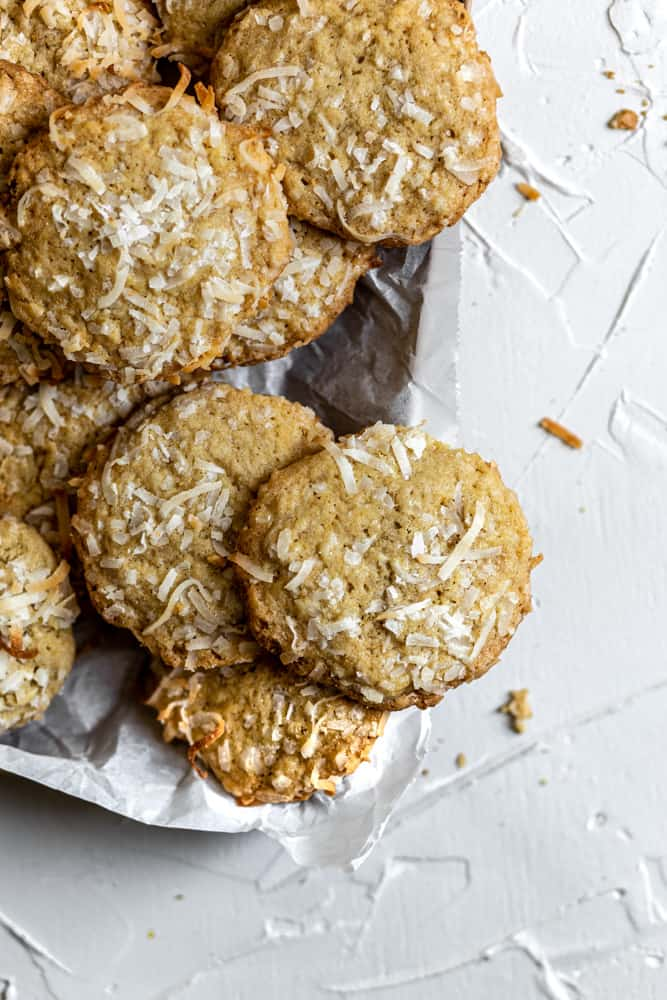 coconut cookies on a cookie sheet on a white background