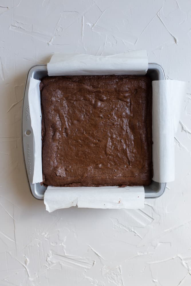 Baked brownies in a parchment line 8x8 pan