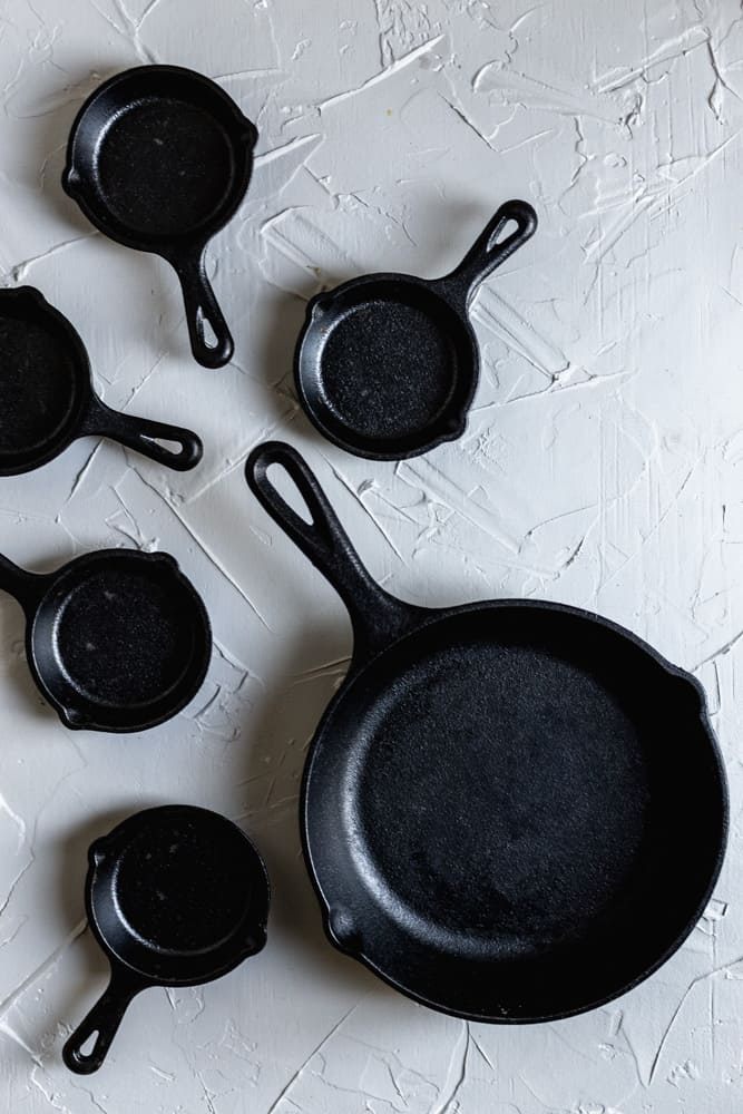 """An 8"""" and 3"""" mini skillets on a gray surface"""