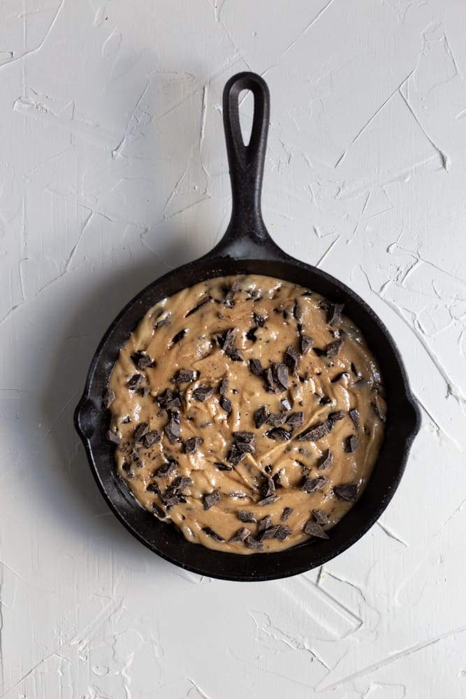 Cookie batter in a cast iron skillet