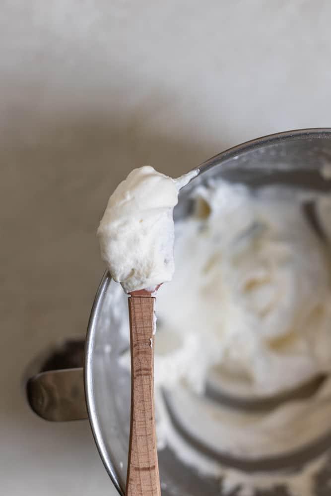 A mini spatula holding up whipped cream