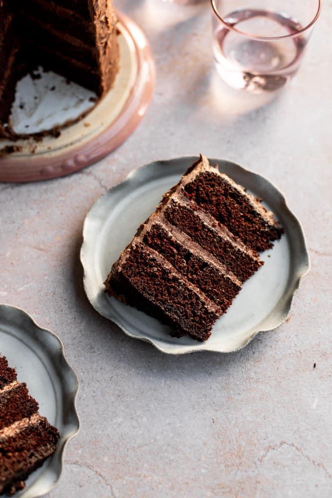 A chocolate cake slice on a gray ruffled plate