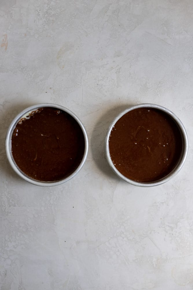 """Chocolate cake batter in 6"""" pans"""