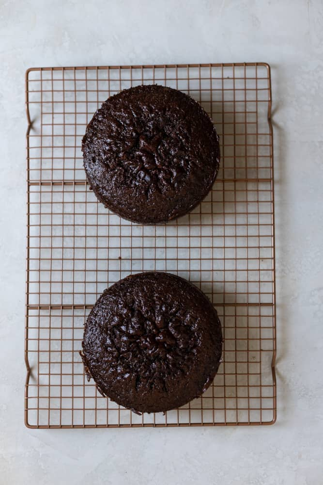 """Cooled 6"""" chocolate cakes on a wire rack"""