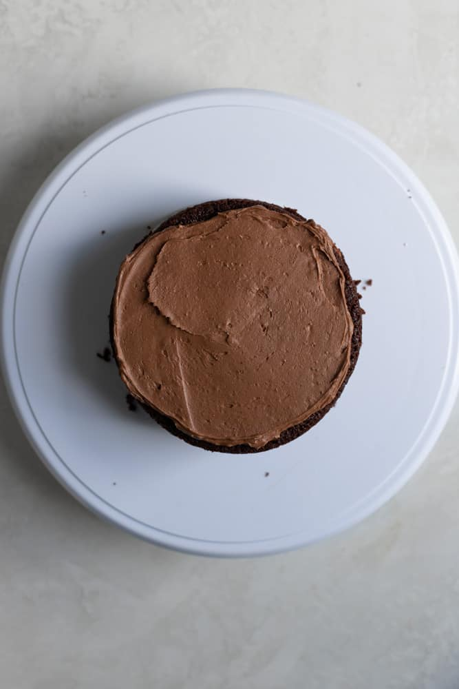 Chocolate buttercream spread on a chocolate cake